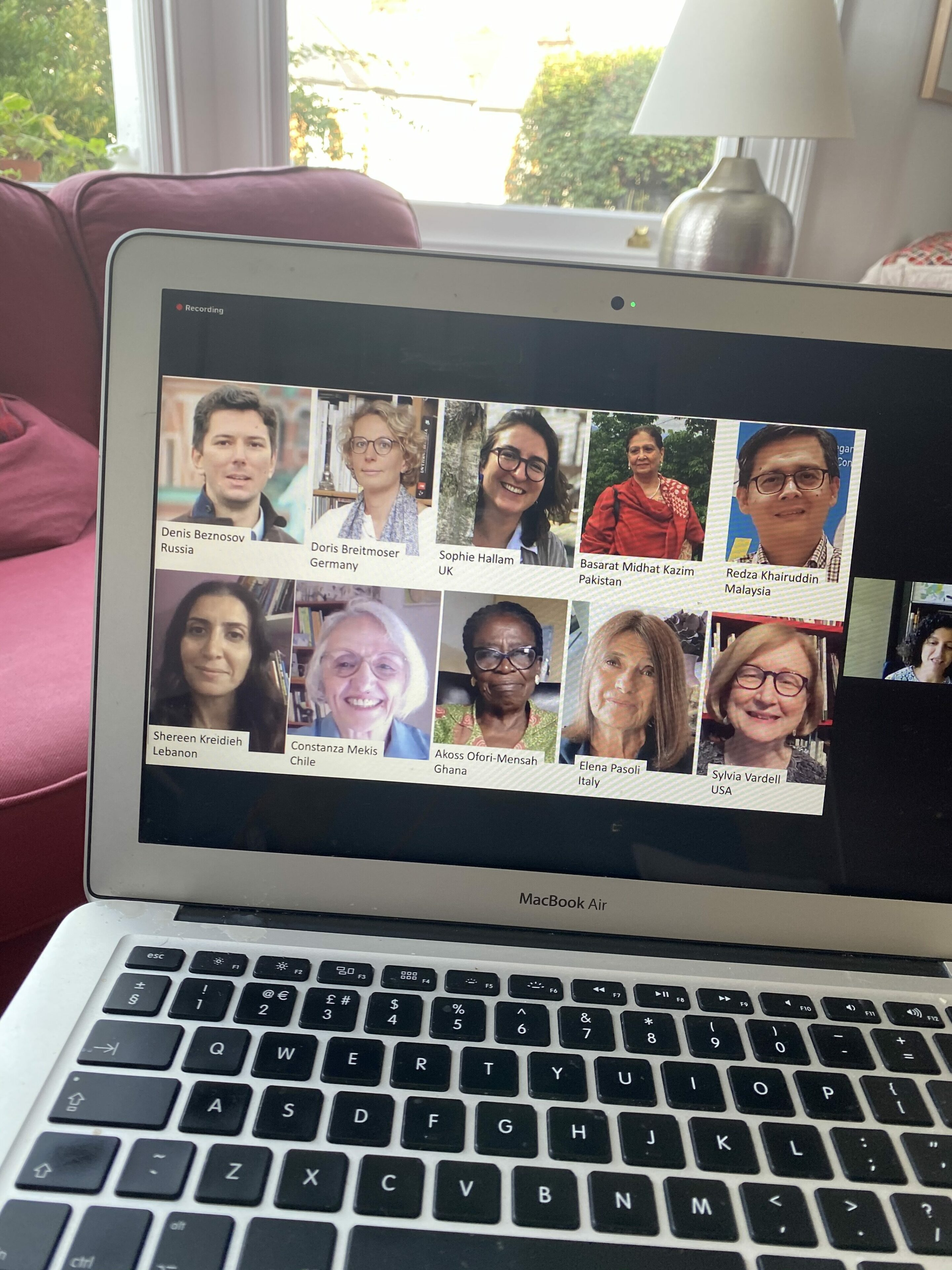 Laptop with portraits of the IBBY Executive Committee Members